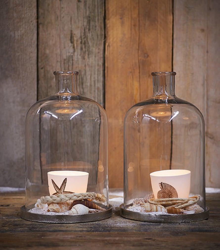 <p><p>Lasikupujen alle voi kerätä rannalta simpukoita, kiviä ja muita luonnon koriste-esineitä. Kuva: Rivièra Maison</p></p>
